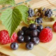Bilberries and raspberries, summer fruits — Stock Photo #4325701