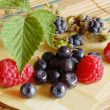 Bilberries and raspberries, summer fruits — Stock Photo