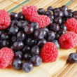 Bilberries and raspberries, summer fruits — Stock Photo #4325702