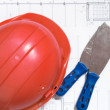 Design draft papers, hard hat, spatula — Stock Photo