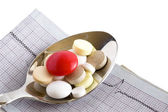 Tablet in spoon and cardiogram — Stock Photo