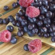 Bilberries and raspberries — Stock Photo