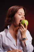Girl sting the apple — Stock Photo