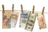 Money laundering on clothesline isolated on white background — Stock Photo