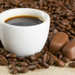 Coffee beans and cap of coffee - Stock Photo