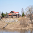 House building on river bank — Stock Photo #2911061