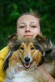 Dog and girl — Stockfoto