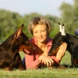 The woman lies between two dogs - Stock Photo