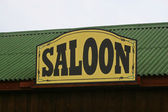 Old Saloon Sign on Weathered — Stock Photo