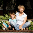 Woman and son sitting on the bench — Stock Photo #3489675