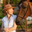 Woman looking to horse — Stock Photo #3489686