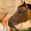 Woman kissing horse — Stock Photo #3489692