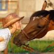 Stock Photo: Womand brown horse