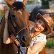 Woman embrace horse — Stock Photo