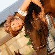 Animals; brown; adult; horse; hat; women; young; pets; on; casual; outdoors - Stock Photo