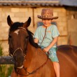 Child on brown horse — Foto Stock
