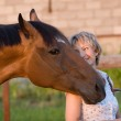 Horse head on womans shoulder — Stock Photo #3489711
