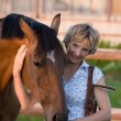 Woman embrace brown horse — Stock Photo