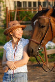Woman looking to horse — Stock Photo