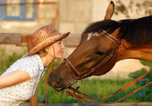 Woman and brown horse — Stock Photo