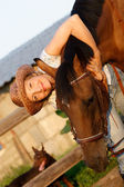 Animals; brown; adult; horse; hat; women; young; pets; on; casual; outdoors — Stock Photo