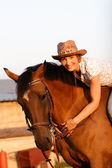Woman on brown horse — Stock Photo