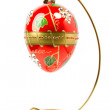 Easter egg hanging on golden stand — Stock Photo