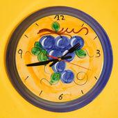Ceramic wall clock on yellow — Stock Photo