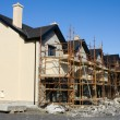 Row of houses with scaffolds - Stock Photo
