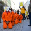 In prison dress protest on the street - Stockfoto