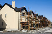 Row of houses with scaffolds — Stock Photo