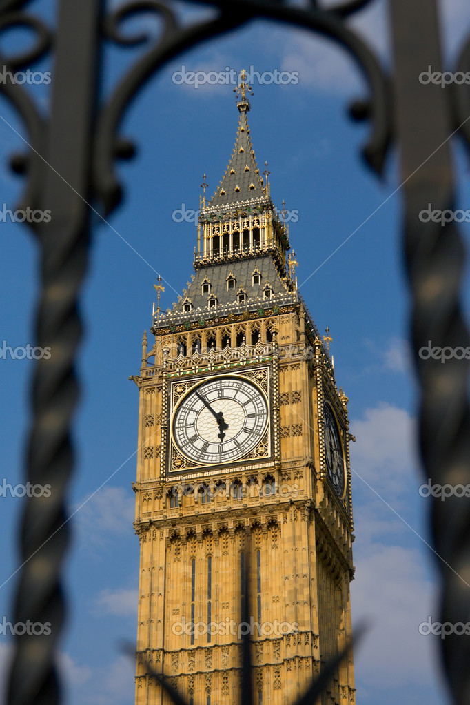 Big Ben tower clock throgh the forged metal grille — Stock Photo #3527408