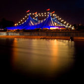 Circus style blue tent and row of lights at night — Stock Photo
