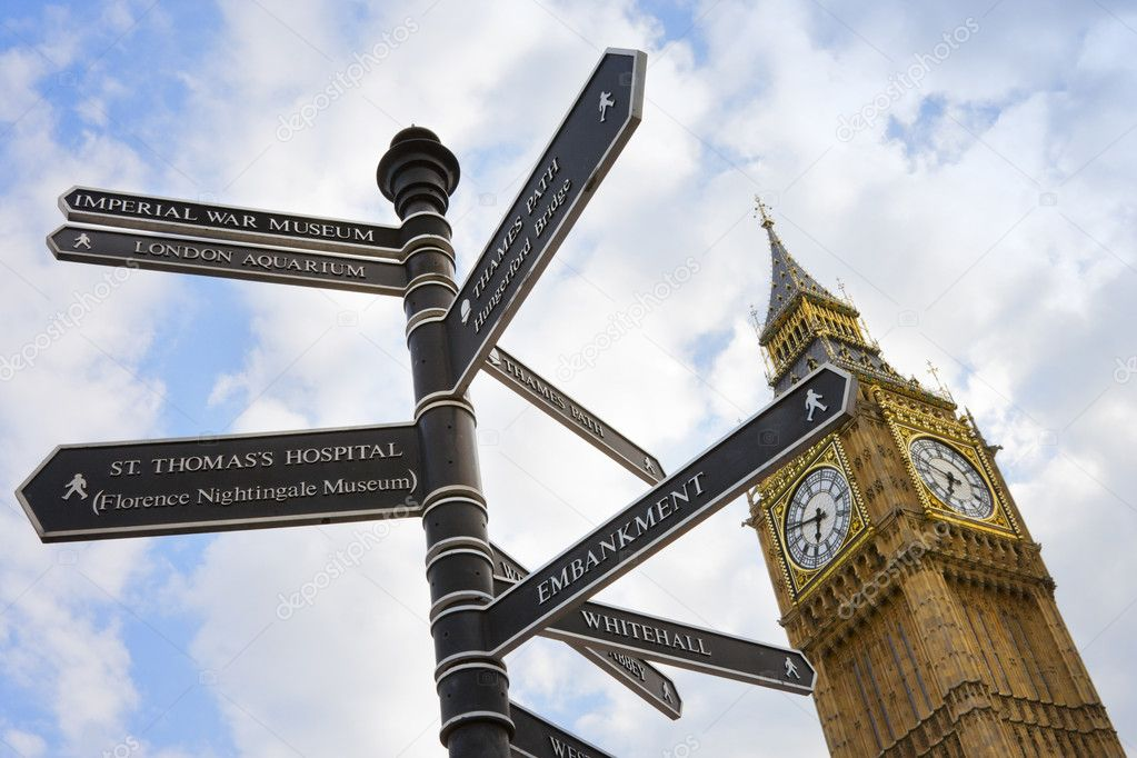 Signpost pole with directions and Big Ben with blue sky and clouds in London, UK — Stock Photo #3568232