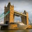 Cruise ship passing Tower Bridge at sunset - Stock Photo