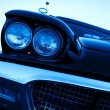 Vintage car with chromium-plated headlight - Stock Photo