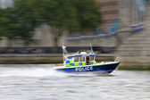 Police motorboat in motion — Stock Photo