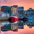 Morning view on row of buildings and fishing boats in docks, HDR — Stock Photo #3675592