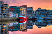 Morning view on row of buildings and fishing boats in docks, HDR — Stock Photo