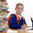 School boy sitting at the desk — Stock Photo