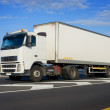 Truck with big white trailer — Stock Photo