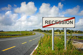 Road with recession sign crossed with red line — Stok fotoğraf