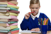 Schoolboy at the desk — Stock Photo
