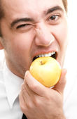 Businessman Eating Apple — Stock Photo