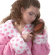 Teenager  in a pink dressing gown — Stock Photo