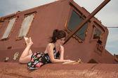 Girl, book & old rusty mechanism — Stockfoto