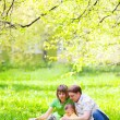 Stock Photo: Family in the grass
