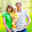 Family in the grass — Stock Photo #3434870