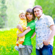 Family in the grass — Stock Photo