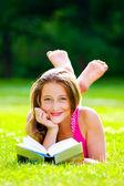Beautiful girl with book — Stock Photo